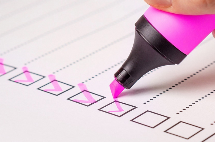 Highlighter checking off items in a checklist